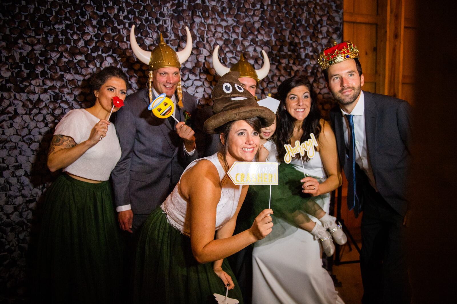 Wedding party poses for a photo booth photo wearing Viking helmets